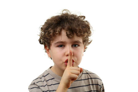 noiseless: Boy with a finger on his lips Stock Photo