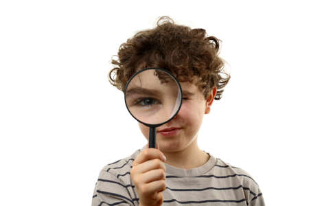 inspector kid: Boy using magnifying glass