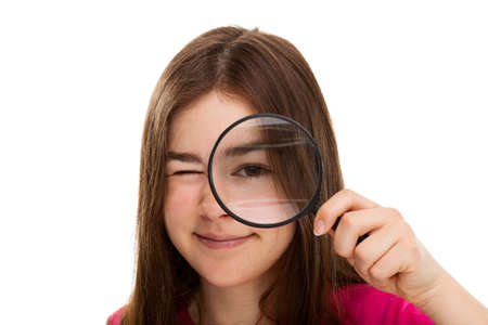 inspector kid: Young girl holding magnifying glass