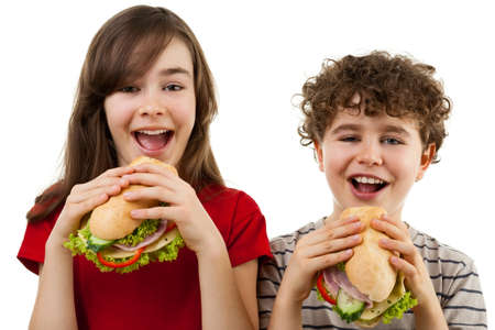 large family portrait: Kids eating healthy sandwiches isolated on white background Stock Photo