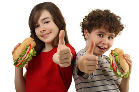 Kids eating healthy sandwiches isolated on white background Stock Photo