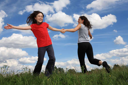 Mother and daughter playing outdoors photo