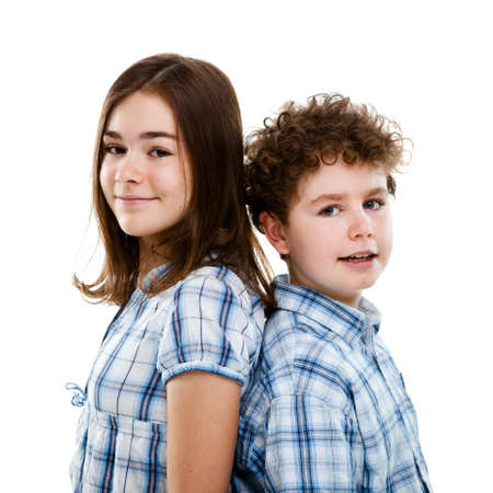 10 to 12 years: Close up of girl and boy on white background Stock Photo