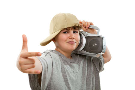 10 to 12 years old: Close up of boy listening to radio