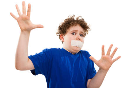 10 to 12 years old: Boy with adhesive tape on mouth