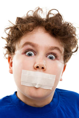 10 to 12 years old: Close up of boy with adhesive tape on mouth