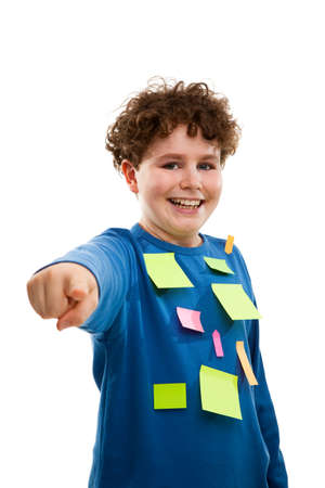 10 to 12 years old: Boy with adhesive notes on his shirt