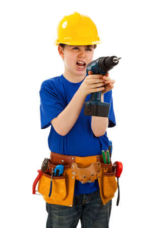 10 to 12 years: Boy as a construction worker holding a drill