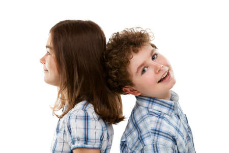 10 to 12 years: Girl and boy on white background Stock Photo