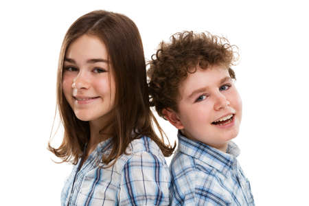 10 to 12 years old: Close up of girl and boy on white background Stock Photo
