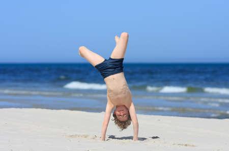 10 to 12 years old: Boy having fun on the beach