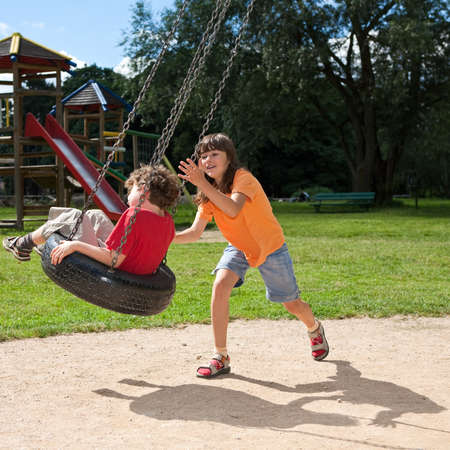 Girl and boy at the playground photo