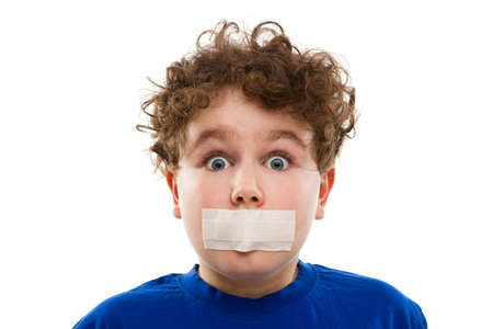10 to 12 years: Close up of boy with adhesive tape on mouth