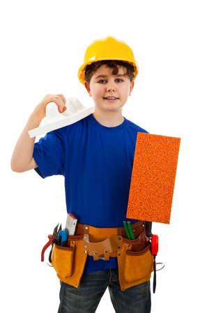 10 to 12 years old: Boy as a construction worker holding a spade Stock Photo