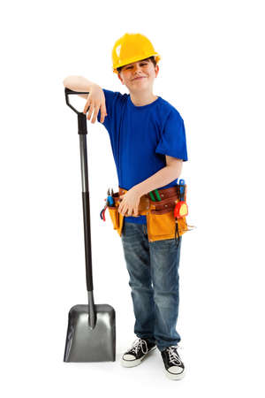 10 to 12 years old: Boy as a construction worker holding a shovel