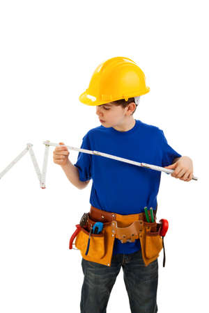 yardstick: Boy as a construction worker holding a yardstick