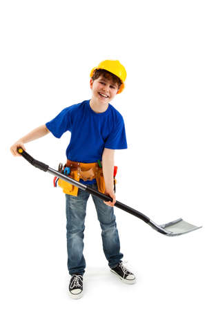 10 12 years: Boy as a construction worker holding a spade Stock Photo