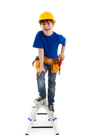 10 to 12 years old: Boy dressed as a construction worker Stock Photo