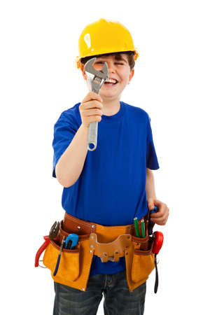 10 to 12 years old: Boy as a construction worker holding a spanner