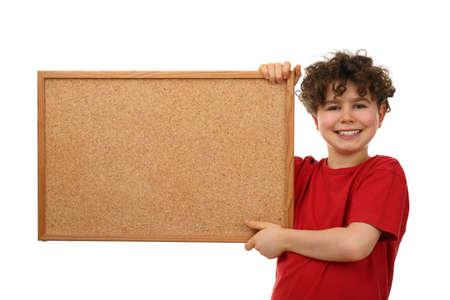 corkboard: Boy holding a corkboard