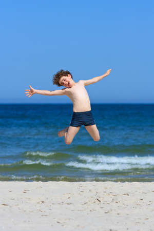 10 12 years: Boy having fun on the beach