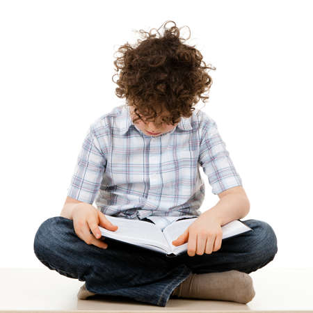 Front view of boy reading a book  photo