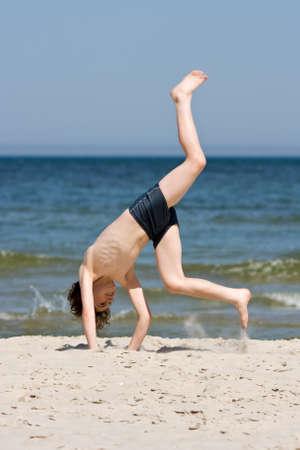 boy swim: Close up of boy having fun on the beach Stock Photo