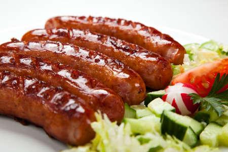 chorizos asados: Cierre de embutidos y verduras a la parrilla