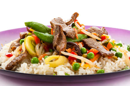 cooked meat: Close up of cooked meat with vegetables and rice