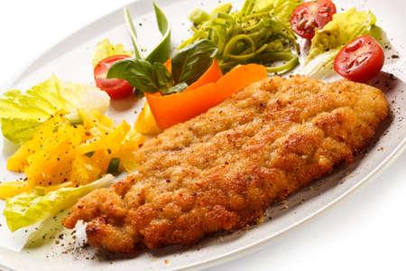 pork chop: Top view of fried pork chop and vegetable salad