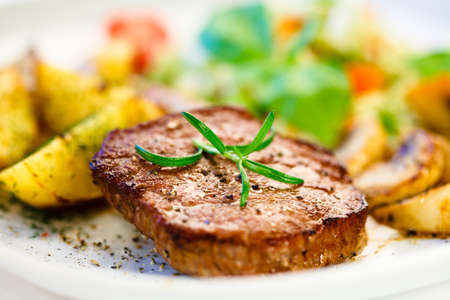 western food: Close up of a plate of grilled steak