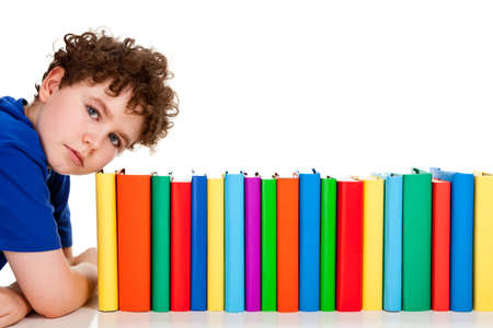 Boy and a row of books on white background Stock Photo