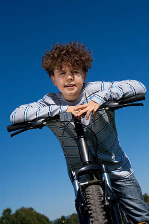 Young boy riding a bike  photo