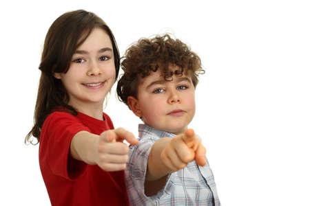 child finger: Happy kids pointing finger at camera