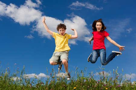 Kids jumping outdoors  Banco de Imagens
