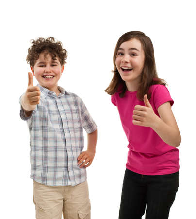 thumbs up sign: Boy and girl showing OK sign isolated on white background