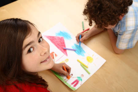 Boy and girl drawing together photo