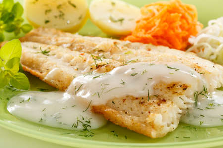 fried fish: Pan fried fish fillet with vegetables