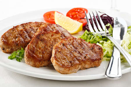 pork chop: Grilled meat with vegetable salad  Stock Photo