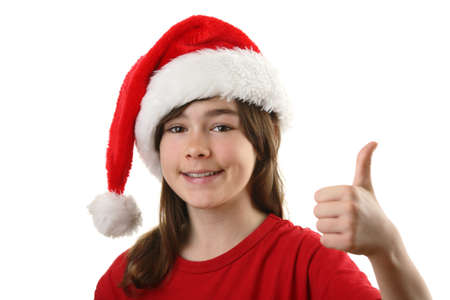 13 14 years: Girl wearing santa hat and giving a thumbs up