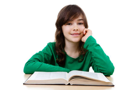 revising: Girl reading a book on the table