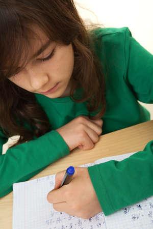 revising: Girl doing her homework on the table