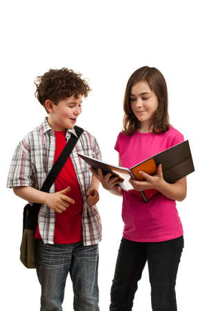 boy book: Boy and girl carrying a bag and looking at a book Stock Photo