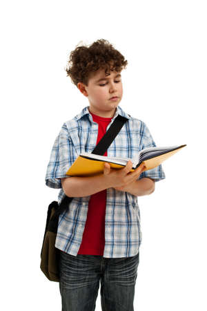 boy book: Boy carrying a backpack and a book