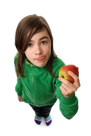 girl licking: Girl eating a red apple Stock Photo