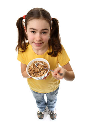 tied hair: Girl with a bowl of cereal Stock Photo