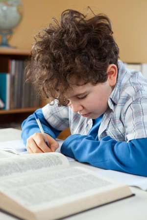 10s: Boy doing homework