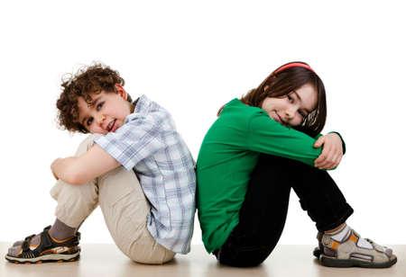 Two siblings sitting down
