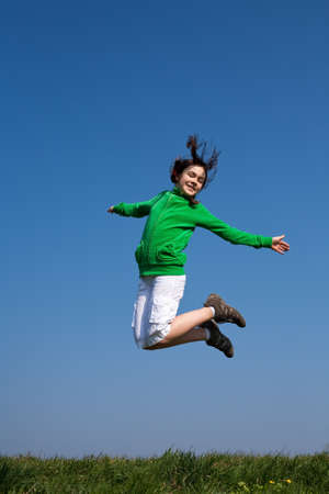 10s: Girl jumping Stock Photo
