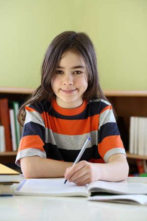 kids writing: Girl studying